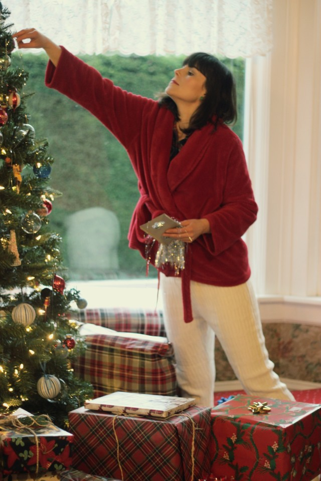 What to wear on Christmas Day, Hue quilted Shue Slippers, Hue Cable Sweater Relaxed leggings, Lord and Taylor Robe, Old Navy Plaid Shirt, Christmas Tree, Leopard skin rug, Holiday Fashion, Hallmark Gift Wrap, Christmas Tree Tinsel