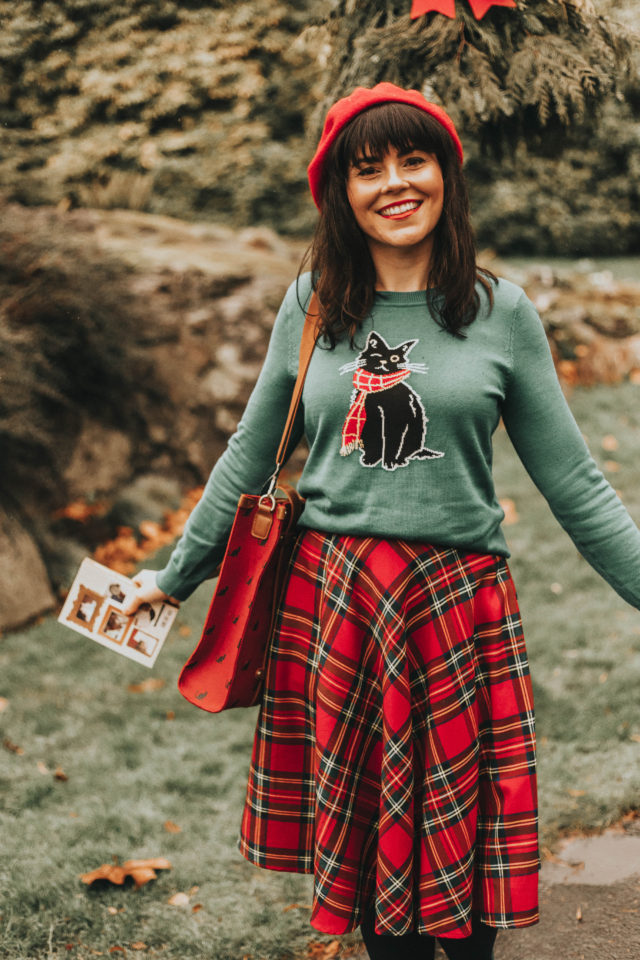 Oscar the One-Eyed Cat Sweater, Potluck Hostess Plaid Skirt, The Zest Is History Heel in Green, Stuff on My Cat Journal, Camp Director Zipped Tote in Crimson Cat, Isn't She Chic? Wool Beret in Red, Modcloth, Cat themed clothing, Cat themed gift guide, Vintage Christmas, Red plaid Skirt, Cat printed bag,